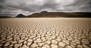 Clouds gather but produce no rain as cracks are seen in the dried up municipal dam in drought-stricken Graaff-Reinet