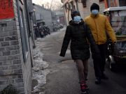 Beijing residents wearing face masks