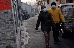 Beijing residents wearing face masks