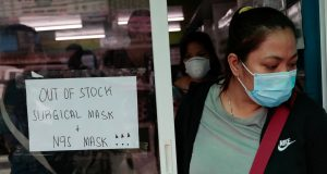 A sign is posted on a medical supply store that says surgical and N95 masks are already out of stock, in Manila,