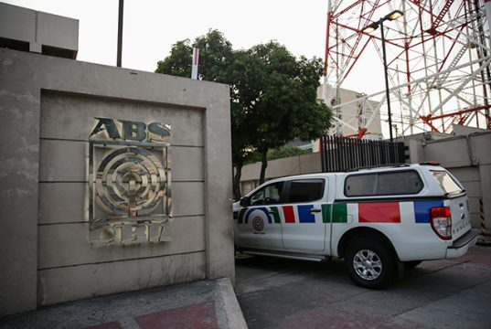 A media crew cab enters the ABS-CBN Broadcasting Center, the office of the country's top broadcast network, following a move by the Philippine government to scrap its franchises, in Quezon City