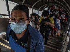 Commuter wearing face mask