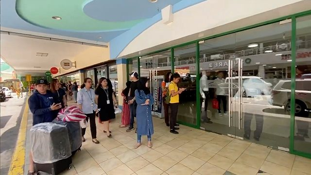 Social media video still shows a security personnel blocking an entrance into in Greenhills shopping centre during a reported hostage situation