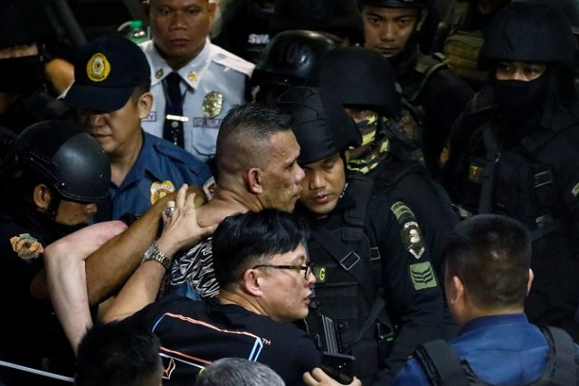 Archie Paray, the gunman and former security guard who took dozens hostage inside a mall, is arrested by police in San Juan, Metro Manila