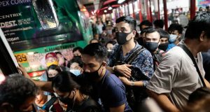 Commuters with masks