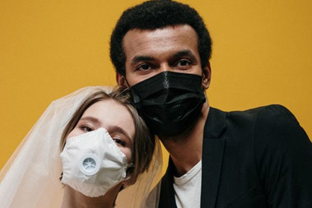People wearing face masks with valves