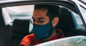 Passenger with face mask