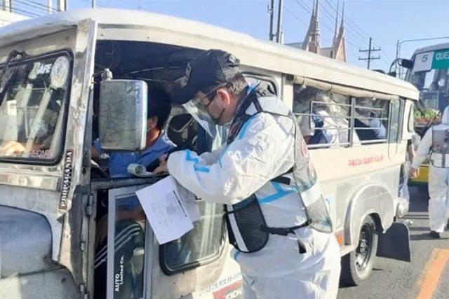 Enforcer in PPE suit