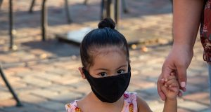 Child with face mask