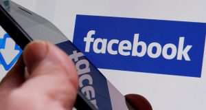 Smartphone and Facebook logo
